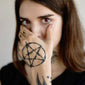 pentagram hand tattoo