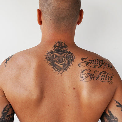sacred heart tattoo back