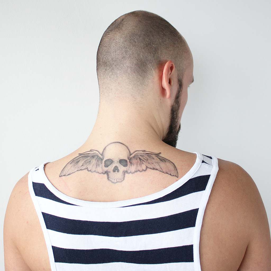 skull with wings tattoo