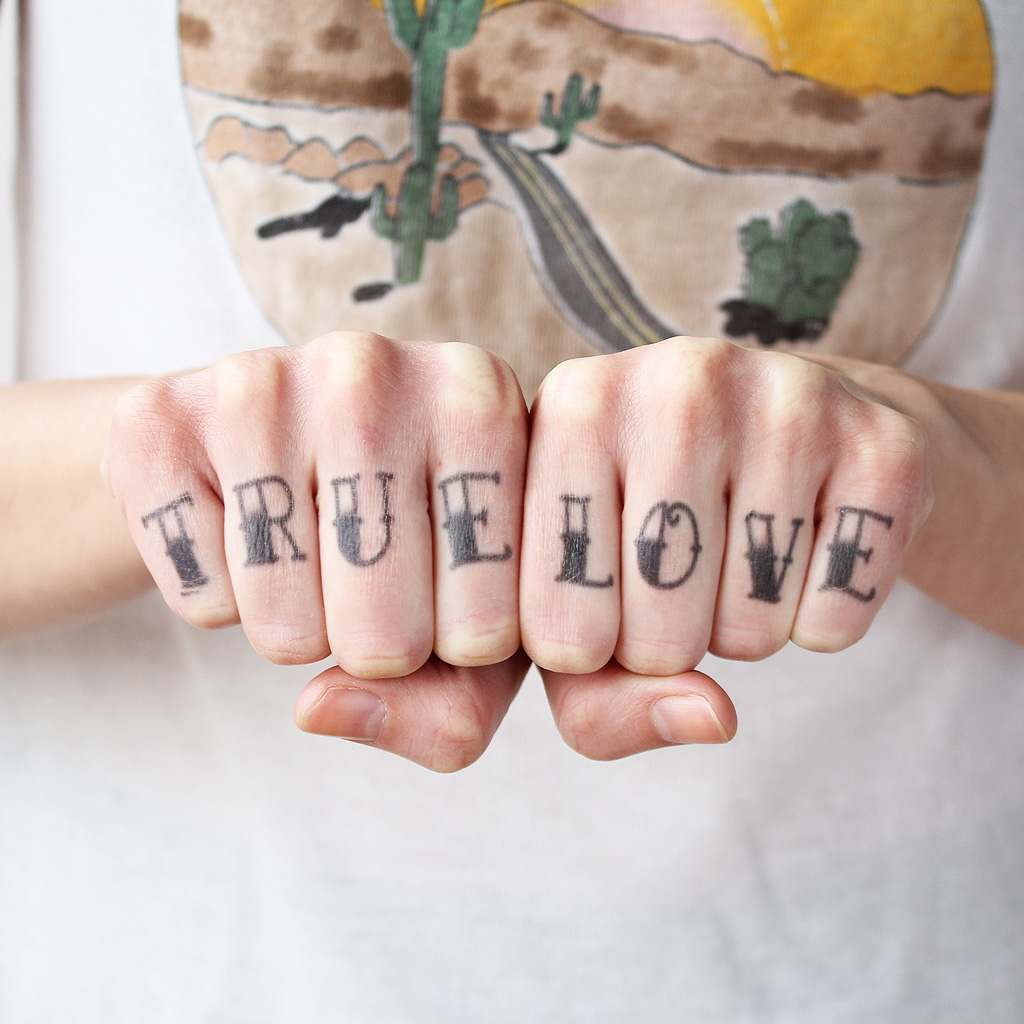 true love finger tattoo