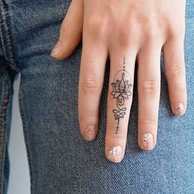 unalome lotus finger tattoo