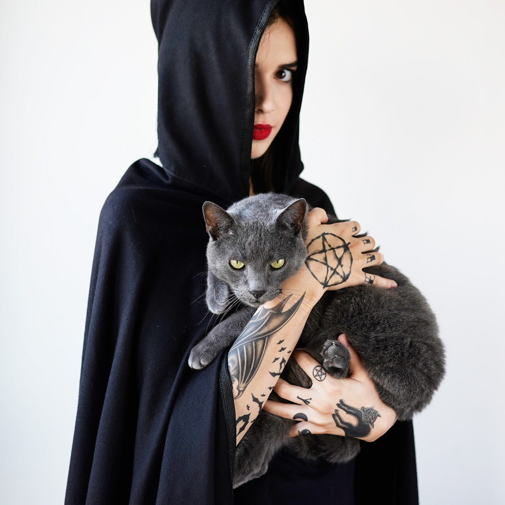 tattooed witch holding a cat