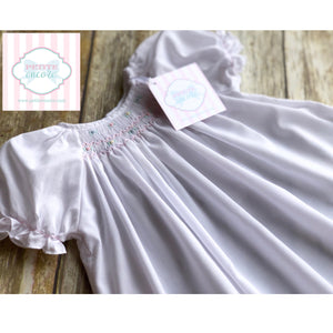 Smocked gown by Petit Ami NB