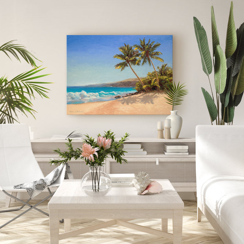 Large tropical wall art canvas of beach and palm trees in home decor setting with tropical plants and white couch and white accent chair