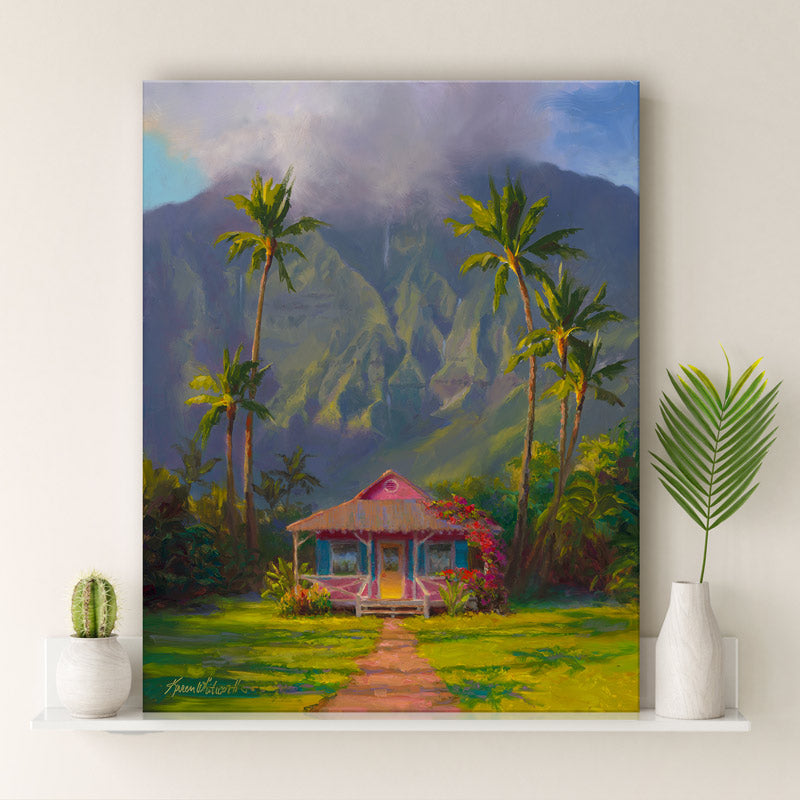 Tropical Hawaiian landscape painting of Hanalei Kauai by gallery artist Karen Whitworth on shelf next to white vase with palm frond