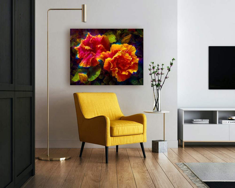 Wall art canvas of tropical Hawaiian hibiscus flowers by gallery artist Karen Whitworth on white wall over a yellow chair in living room