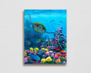 Ocean wall art canvas of green sea turtle swimming through a coral reef with tropical fish