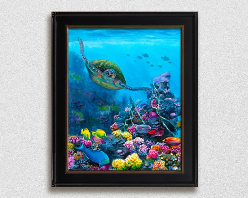 Framed ocean wall art canvas of green sea turtle swimming through a coral reef with tropical fish