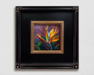Framed painting of tropical bird of paradise flower on white wall by Hawaii Gallery Artist Karen Whitworth