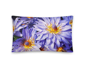 Lumbar throw pillow featuring blue lotus flower art against white background
