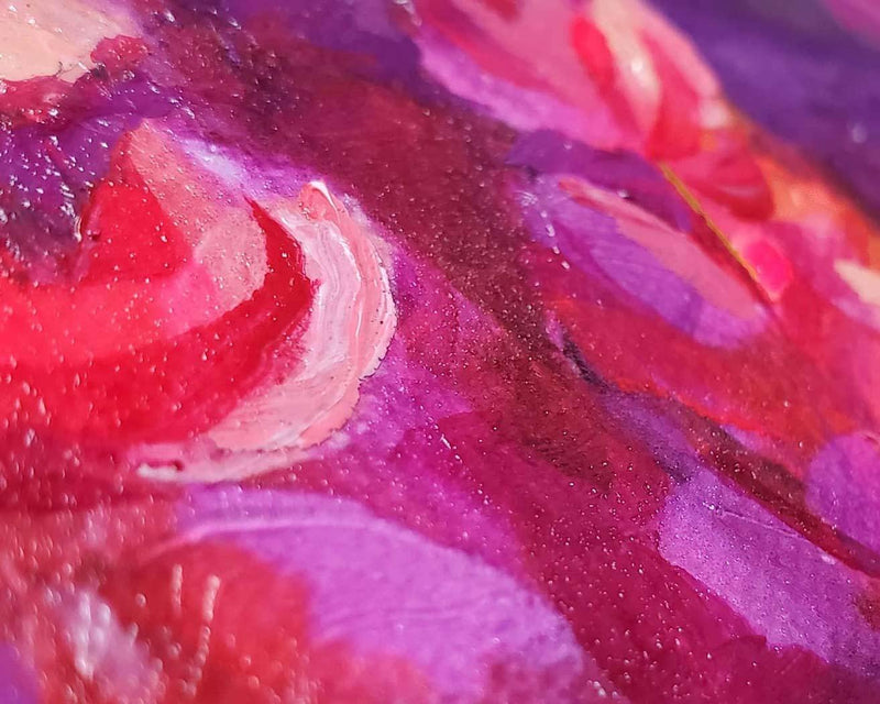 Detail crop of magenta and pink paint