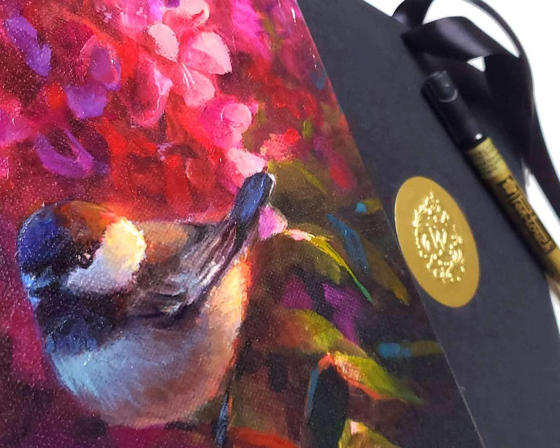 Detail shot of chickadee and fireweed with certificate of authenticity in background