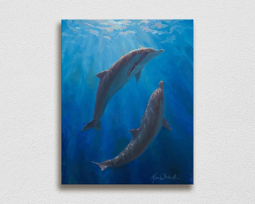 Ocean wall art on canvas of 2 Spinner Dolphins by Karen Whitworth hanging on white wall
