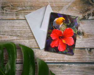An envelope and card featuring art of a tropical Hawaiian Hibiscus flower and an endemic Palila bird on a wood background