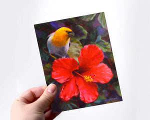 A hand holding a card featuring art of a tropical Hawaiian Hibiscus flower and an endemic Palila bird
