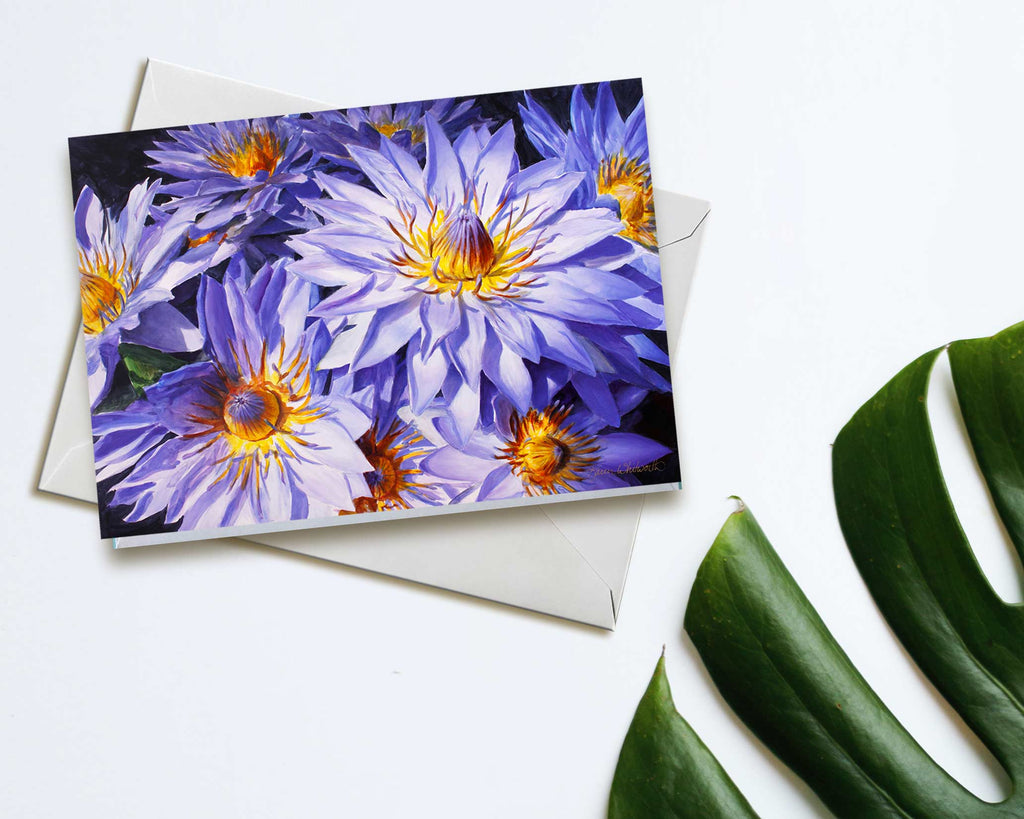 An envelope and card featuring art of tropical Hawaiian Lotus Flowers on white background
