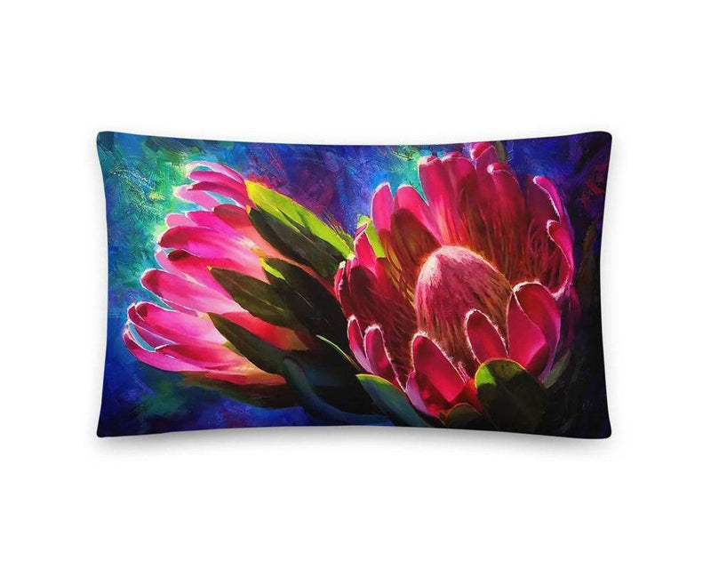 Reversible lumbar throw pillow featuring colorful protea flowers