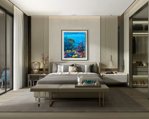 Ocean wall art canvas of green sea turtle swimming through a coral reef with tropical fish hanging on wall above a bed