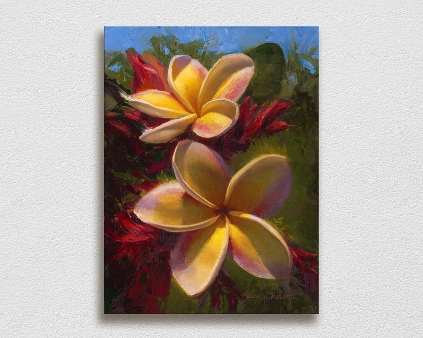 Wall art canvas of tropical Hawaiian Plumeria flowers painting by Hawaii artist Karen Whitworth on white wall