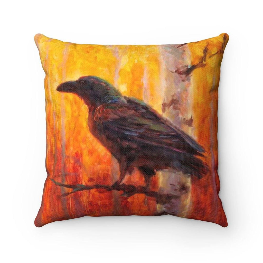 Square Orange and Yellow pillow with a painting of an autumn birch forest in the background and a raven or crow/black bird perched on a branch