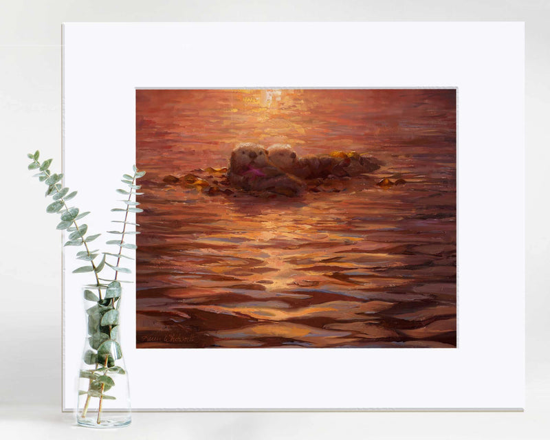 Coastal wall art print of sea otters and sunset by marine artist Karen Whitworth