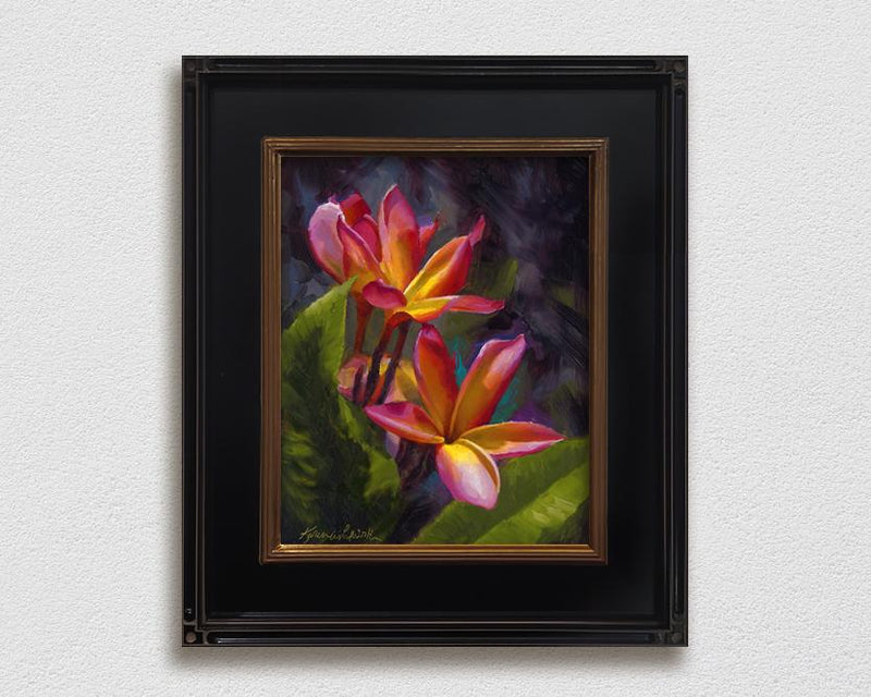 Framed wall art canvas of tropical Hawaiian Plumeria flower blossoms on a white wall