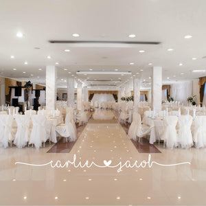 Bride and Groom names in white vinyl in reception hall on wedding dance floor