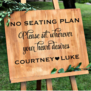 No seating plan please sit wherever your heart desires with bride and groom's names aisle sign