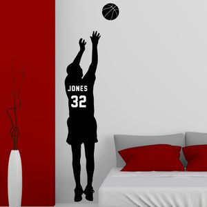 boys bedroom wall decal of basketball player shooting a ball with name and number which can be personalized
