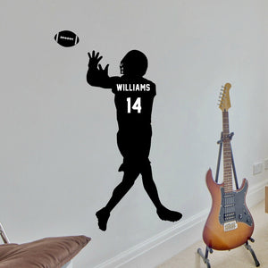 black vinyl wall decal of male football player catching a football with personalized name and team number