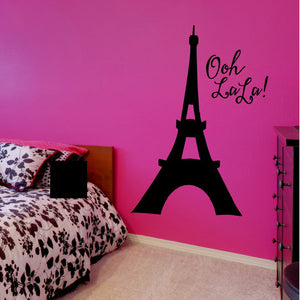 Black Eiffel tower viny wall decal in girl's pink room with the words Ooh La La!