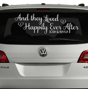 And they loved happily ever after white car decal on Volkswagen SUV personalized with couple's first names