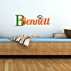 Green and orange vinyl wall decal with child's name and monkey decal