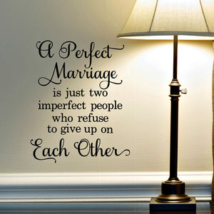 a perfect marriage is just two imperfect people who refuse to give up on each other vinyl wall decal in living room beside lamp