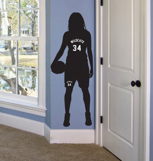 black vinyl wall decal of female basketball player with sports team name and number