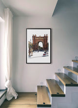 Load image into Gallery viewer, People skating under Arc de Triomf  by Mariscal.  Print with margin framed in black wood