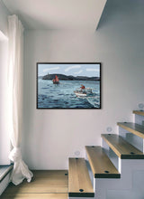 Load image into Gallery viewer, Boat navigating with lighthouse in background by Mariscal.  Print without margin framed in black wood