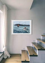 Load image into Gallery viewer, Boat navigating with lighthouse in background by Mariscal.  Print with margin framed in white wood