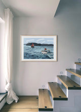 Load image into Gallery viewer, Boat navigating with lighthouse in background by Mariscal.  Print with margin framed in natural wood