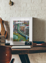 Load image into Gallery viewer, A mixed of activities in a green city painting by Clara Leon.  Print with margin framed in white wood