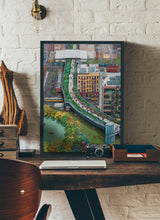 Load image into Gallery viewer, A mixed of activities in a green city painting by Clara Leon.  Print without margin framed in black wood