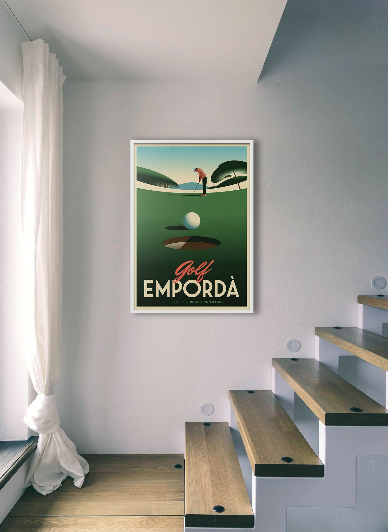 A golf ball in a hole after putting by Ricard Jorge.  Print without margin framed in white wood