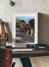 Load image into Gallery viewer, Scene of people around a street bar by Mariscal.  Print with margin framed in white wood