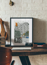 Load image into Gallery viewer, Motorbike an orange traffic lights drawing by Miguel Herranz.  Print with margin framed in black wood