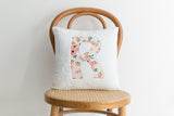 monogrammed baby pillow for girl nursery in pink watercolor florals