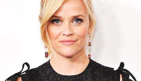 Reese Witherspoon, in cool gemstone earrings, representing a new age for women in Hollywood.