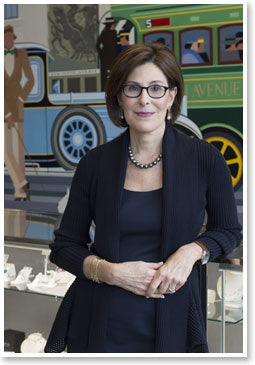 Esther Fortunoff in their New York store leaning against a display case full of quality jewelry