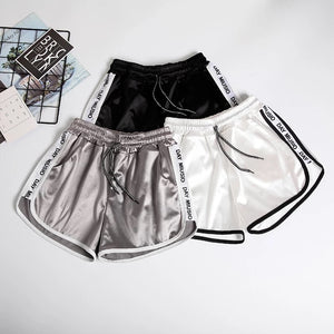 'Somebody else' satin feel shorts