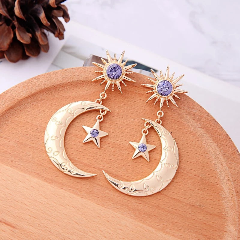 Gold moon statement earrings