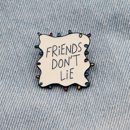 'Friends don't lie' enamel pin